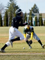Delone Catholic's Evan Haymaker tries to run out a bunt during a 2015 game against York Catholic. Now a junior, Haymaker is the Squires' primary starting pitcher.