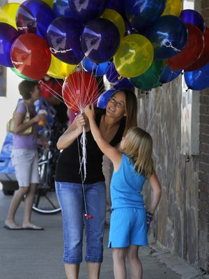 Katie Krutzfield picks out the perfect balloon before the Pet and Doll Parade at a previous Marias County Fair. The fair takes place July 19-23 in Shelby.