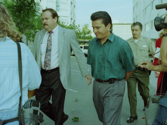 Gonzalez, hand-cuffed, is paraded through Riverside on way to his arraignment, Oct. 28, 1993.