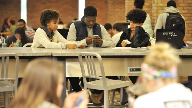 Students, from left, Micalyn Foreman, 21, of Detroit; Arinze Okafor, 20, of Lansing; and Elizabeth Wells, 21, of Southfield spend time at the Oakland Center at Oakland University. Officials are considering expanding the space.