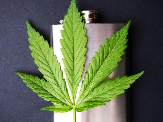 Marijuana leaf on a hip flask