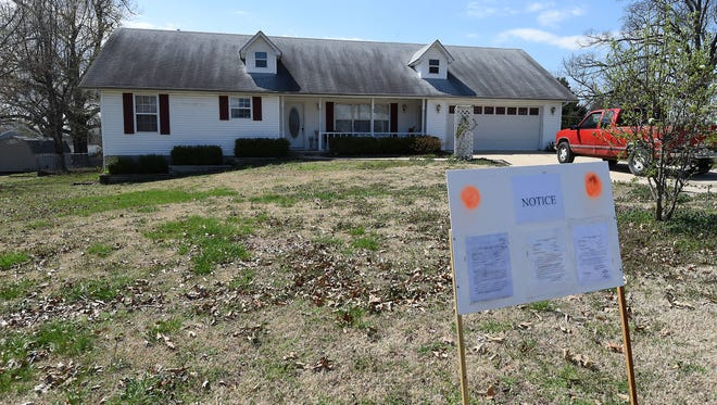 This house at 79 Crest Way in Gassville will be auctioned at 10 a.m. April 20 to satisfy a $75,000 judgment against Affordable Bail Bonds, Inc. The Mountain Home company lost an appeal to the state Supreme Court and will lose the property that was used as collateral in a bond forfeiture case.