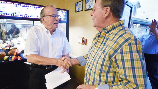"""Irl Dean Rhodes, left, greets Curtis Kirby, as Kirby and other regulars and guests arrive at Golden Corral in Flowood for a monthly """"Breakfast Club"""" to talk politics and hear from local candidates."""