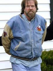 Earl Bradley, a Lewes doctor, is shown in police custody