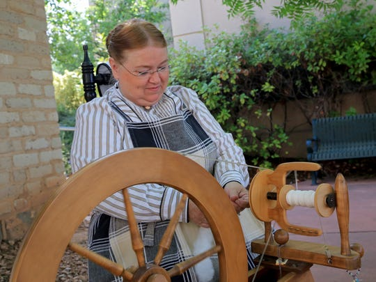 Janet Smith spins cotton Thursday morning prior to the Historic St. George Live tour at the Pioneer Center for the Arts.