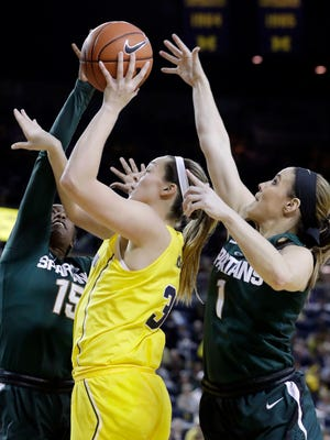 Center Hallie Thome, middle, has come up huge during Michigan's WNIT run.