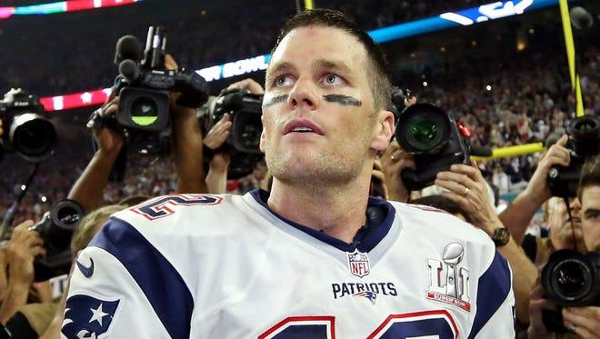 New England Patriots quarterback Tom Brady (12) celebrates after beating the Atlanta Falcons during Super Bowl LI at NRG Stadium.