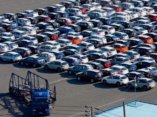 Cars for export park at Yokohama port, south of Tokyo.