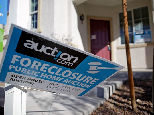 This 2010 file photo shows a sign in front of a foreclosed