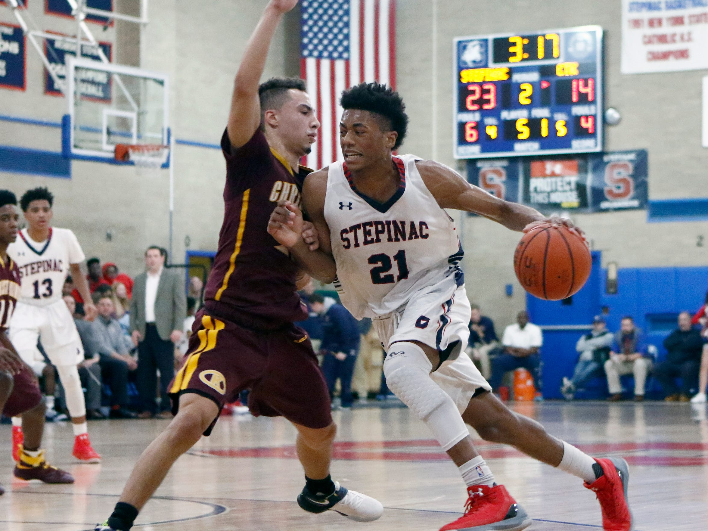 Stepinac's Alan Griffin (21) drives against Christ