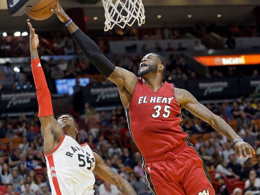 Miami Heat forward Willie Reed (35) blocks a shot by Toronto Raptors guard Delon Wright during the first half of an NBA basketball game, Saturday, March 11, 2017, in Miami. (AP Photo/Alan Diaz)