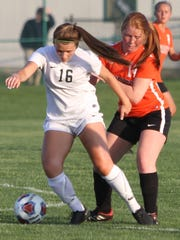 Novi's Jessie Bandyk (16) battles a Brighton player