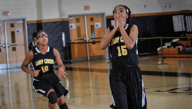 Piscataway's Kendrea Williams (15) reacts after making the game-winning basket as time expires against South Brunswick with teammate Aubri McKoy on Jan. 12 at South Brunswick High School.