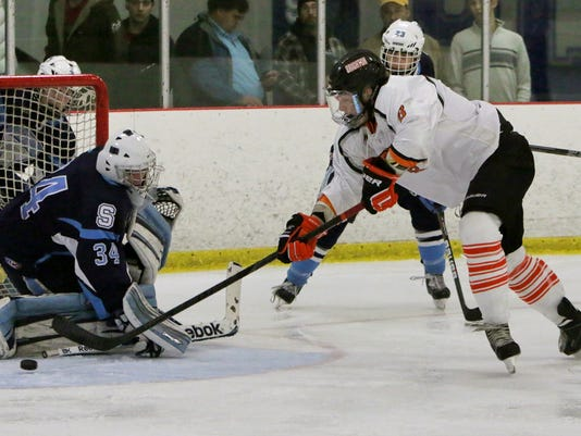 Zach Vitkuske wraps the puck around the GK for his 2nd goal.jpg