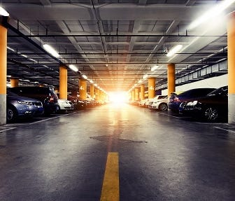 Handout photo provided by INRIX shows cars parked in an underground garage.