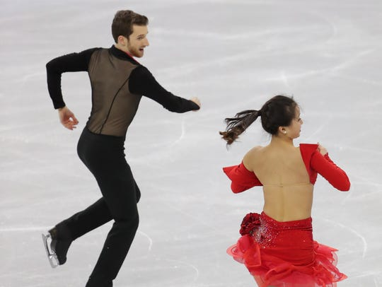 Novi-trained ice dancer Yura Min skates during the Olympic team event.