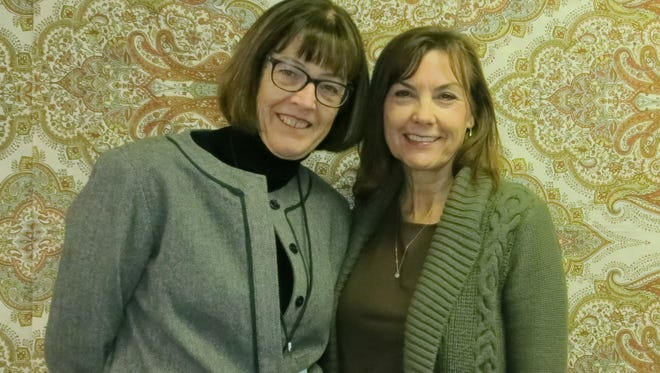 Ellen Jellison of Redding (left) and Carol Murphy of Palo Cedro attend the Writers Forum December Read-Around and Potluck on Dec. 10 at All Saints Episcopal Church in Redding.