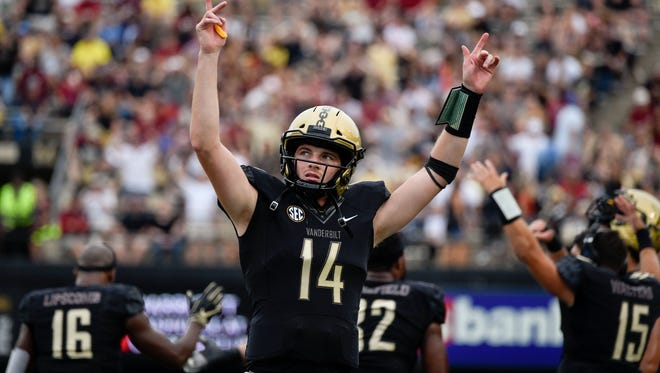 Vanderbilt quarterback Kyle Shurmur (14) reacts after it was ruled that wide receiver Kalija Lipscomb (16) scored a touchdown against South Carolina during the first half at Vanderbilt University in Nashville, Tenn., Saturday, Sept. 22, 2018.
