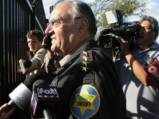 Arpaio speaks to protesters after a 2010 press conference highlighting one of the sheriff's crime-suppression sweeps, aimed at employers who hired illegal immigrants.