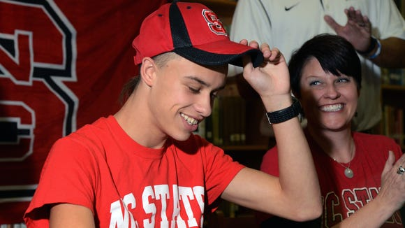 East Henderson senior Tanis Baldwin signed to run college cross country and track for N.C. State in November.