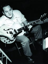 Les Paul is in his natural setting - with guitar -