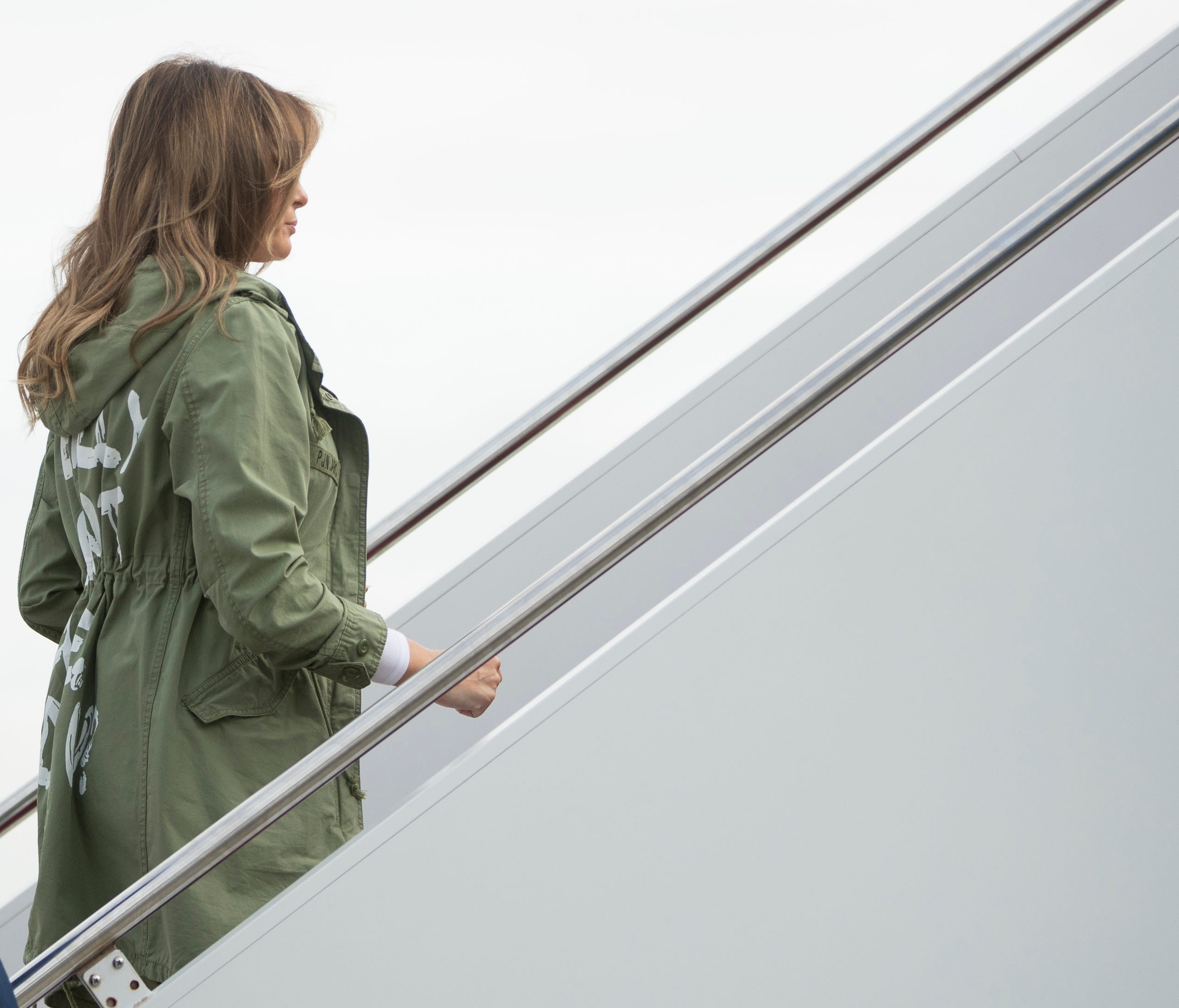 First lady Melania Trump boards a plane at Andrews Air Force Base, Md., June 21, 2018, to travel to Texas.