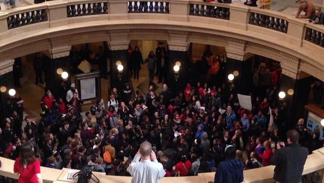 """Protesters in the state Capitol rotunda chant, """"arms up, don't shoot"""" at Monday's rally in the wake of the shooting death of Tony Robinson, a 19-year-old black man. Robinson was shot Friday by a white Madison police officer."""