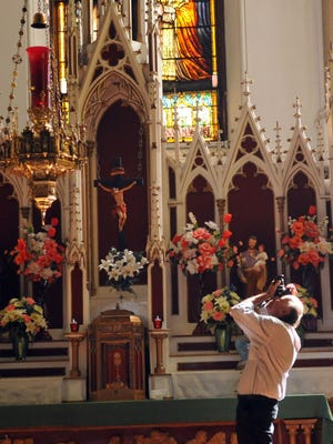 City of Paterson Historic Preservation Commission hosts tour of Paterson churches with famed stained glass windows. St.Josephs Church  (Catholic) A man takes pictures at the alter     Don Smith/staff photographer