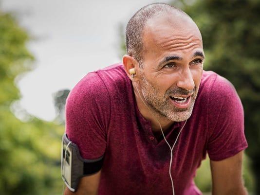 Sweaty mature jogger