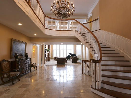 The foyer: The graceful curve of the staircase breaks up this expansive space.