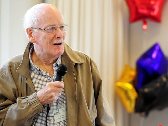 """Art Burr speaks to those in attendance after being presented the inaugural """"Library Champion Award,"""" which has been named in his honor, during the volunteer appreciation ice cream social Sunday at the Keizer Heritage Center."""