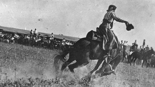 """Fannie Sperry Steele earned the title """"Lady Bucking Horse Champion of the World"""" at the Calgary Stampede in 1912 and 1913. In this photograph, she rides Dismal Dick at the Windham roundup in 1920."""