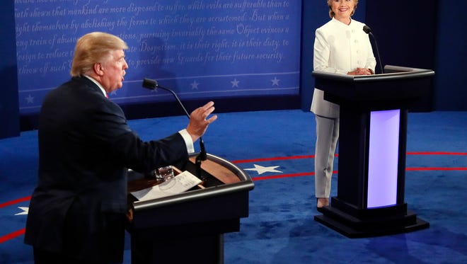 Republican presidential nominee Donald Trump debates Democratic presidential nominee Hillary Clinton during the third presidential debate Oct. 19, 2016, at UNLV in Las Vegas.