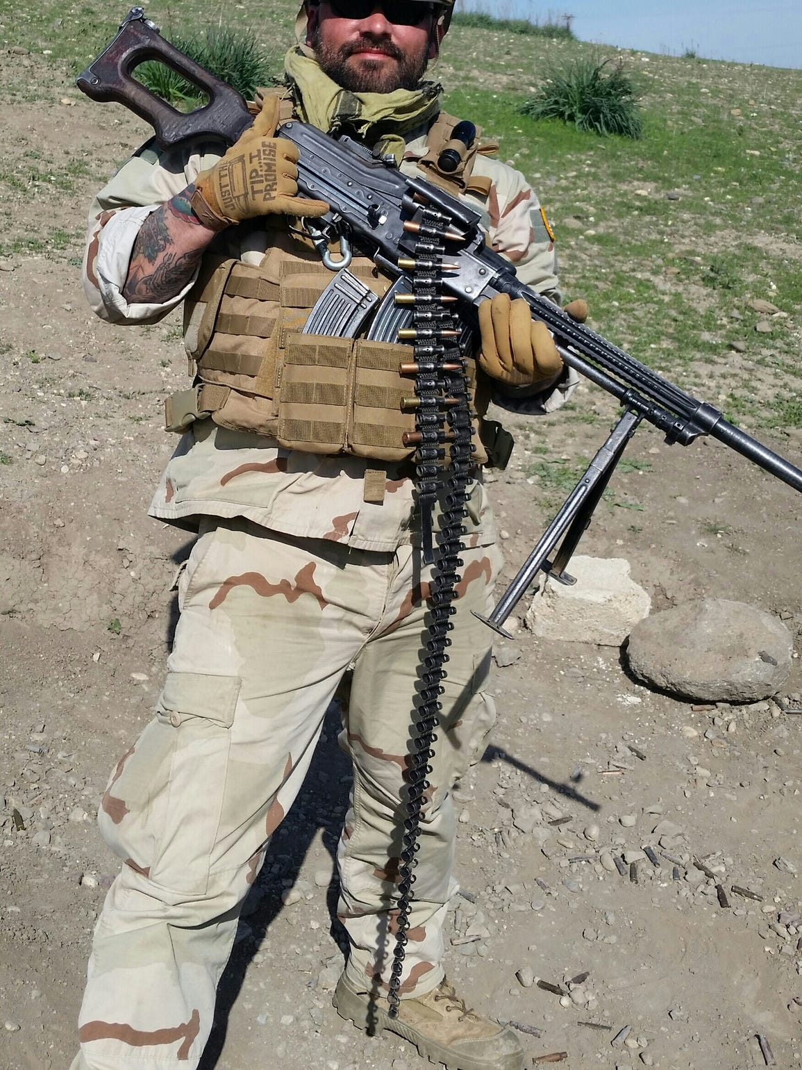 Anthony DelGatto, of Sea Bright, poses with his PKM