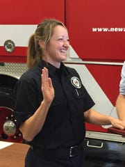 Sara Nethers gets sworn in as a Newark firefighter