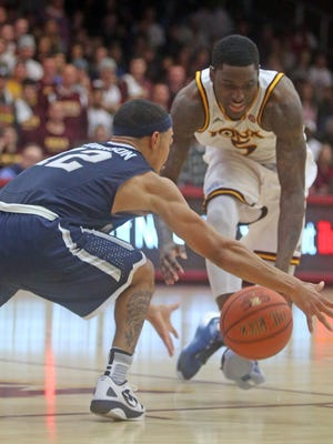 Monmouth's Justin Robinson grabs a loose ball after Iona's A.J. English lost control during a MAAC conference game at Iona College Jan. 15, 2016. Monmouth defeated Iona 110-102.