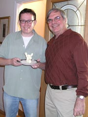 """Former Des Moines Register sports columnist Bryce Miller (left) and former Des Moines Register editor Paul Anger pose with a butter cow head at a party in Michigan in May 2007.  Norma """"Duffy"""" Lyon sculpted the butter cow head for the Iowa themed party."""