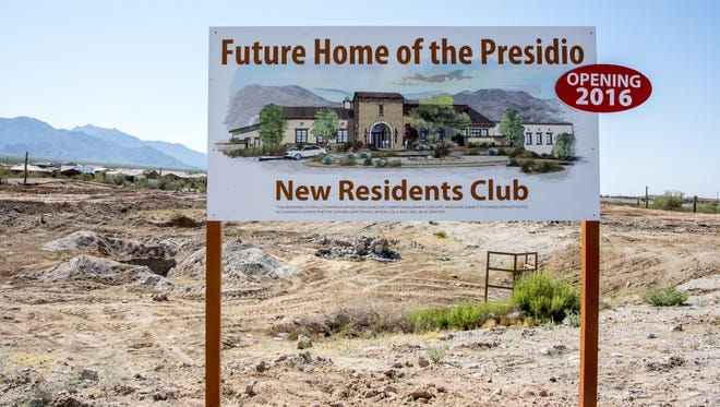 A sign tells onlookers to expect the Presidio to open in 2016.