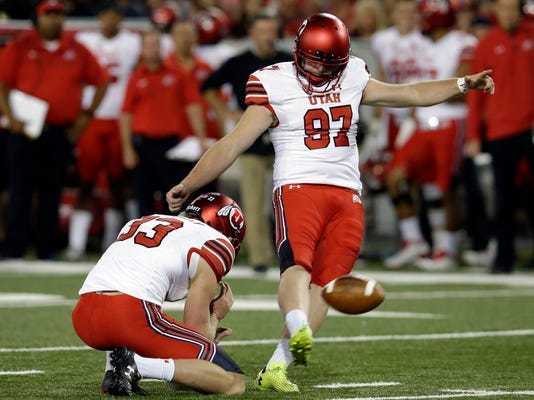 FILE - In this Sept. 22, 2017, file photo, Utah place kicker Matt Gay (97) kicks in the second half of an NCAA college football game against Arizona in Tucson, Ariz. West Virginia will play Utah in the Heart of Dallas Bowl on Tuesday, Dec. 26. (AP Photo/Rick Scuteri, File)