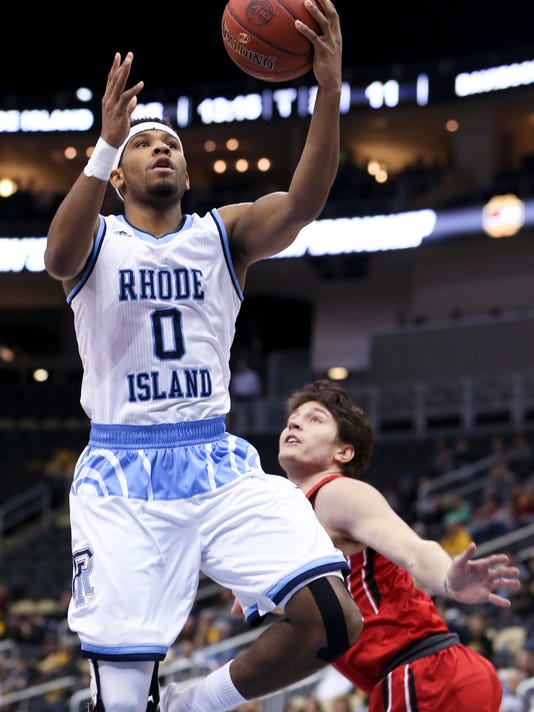 Rhode Island's E.C. Matthews (0) shoots over Davidson's Rusty Reigel during the first half of an NCAA college basketball game in the Atlantic 10 tournament semifinals Saturday, March 11, 2017, in Pittsburgh. Rhode Island won 84-60 to advance to the championship game. (AP Photo/Keith Srakocic)