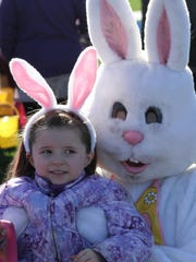 London Isaacson, 4, takes a photo last week with the Easter Bunny.
