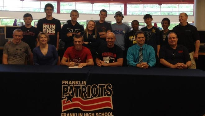 Keenan Jones was surrounded by family and friends when he signed his letter of intent to run for  Saginaw Valley State University.