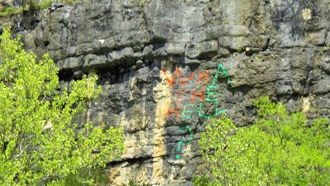 A visitor on the Jacks Fork River took this photo of vandalism on a high cliff in April. The words say: Wha the hell?