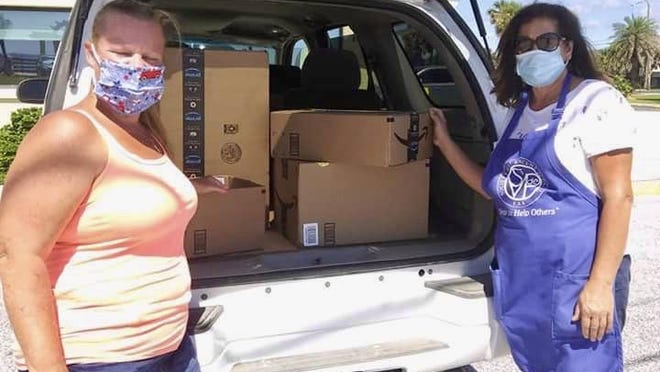 Christina Markoff, chief executive officer of the Our Children First Foundation, Inc., received donations from a number of community members, including Susan Masselle, president of Saint Bernadette Conference of Saint Vincent De Paul in Ormond Beach. The Catholic lay organization purchased reading books, toothbrushes and other supplies that will be included in hundreds of care packages.