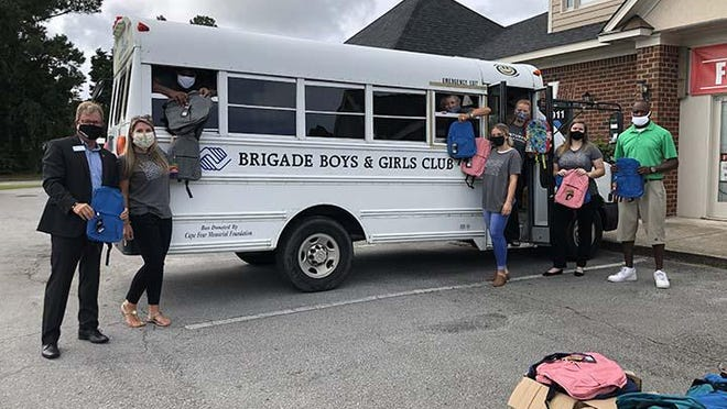 "Century 21 Sweyer and Associates continued its tradition of the ""Back to School Book Bag Giveaway."" The Jacksonville office delivered free book bags to schools in the area, including the Brigade Boys and Girls Club-Onslow County, Jacksonville High School, and the Childcare Network. Over 500 book bags were distributed."
