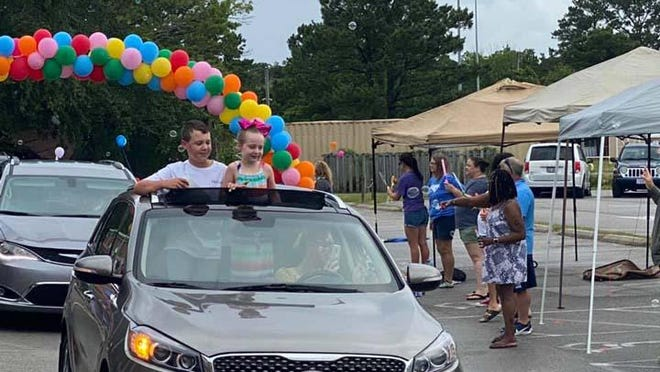 Carteret County Public Schools, like many schools in the area celebrated the last day of school with car parades.