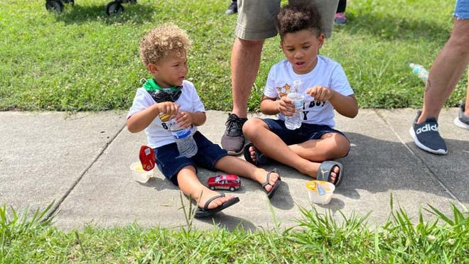 "Javier and Johan Ortiz recently attended the protest against the death of Minneapolis resident, George Floyd, held in Jacksonville. Their mom, Regina said ""The protest was peaceful and people were sweet, accommodating and made sure they had water."""