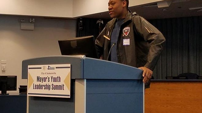 Jacksonville Youth Council Chairman Adejuwon Ojebuoboh welcomes the participants at a Mayor's Youth Leadership Summit.