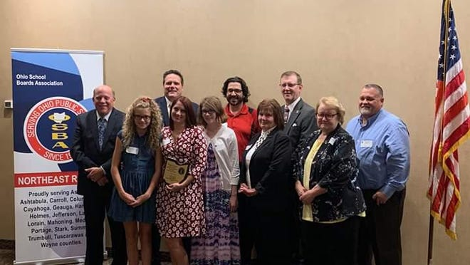 Springfield Local Schools Treasurer Chris Adams, Schrop Parent Teacher Group President Amy Burt and Board of Education member Mary Lou Dodson were honored by Ohio School Boards Association Northeast Region for their service to education.