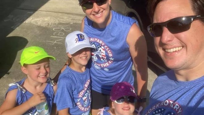 Chad Flickenger and his wife, Ketti, and their children, Cam, Hazel and Amelia, participated in this year's virtual York Four on the Fourth road race from their home in  Shelbyville, Kentucky.